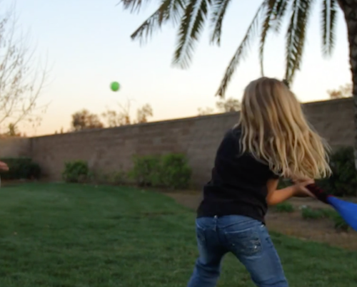 Father and daughter playing baseball