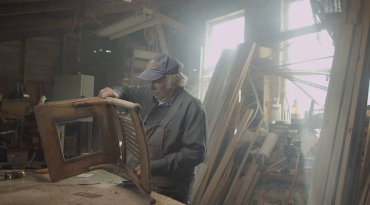 Man working on wooden chair