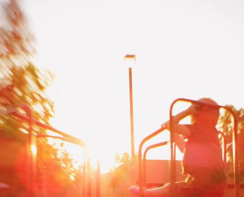 Child playing at sunset