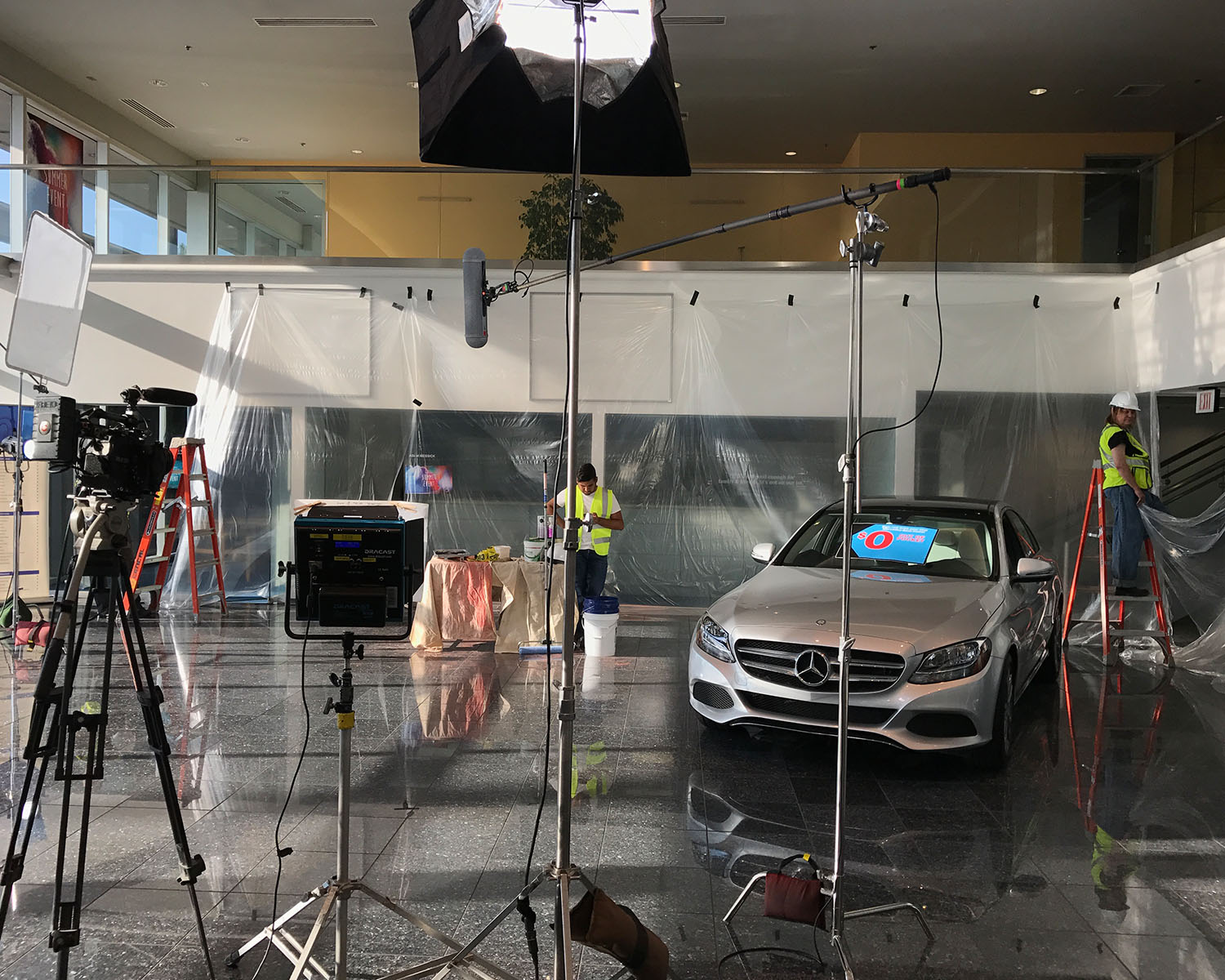 Filming in a car dealership