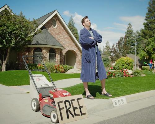 Man giving away lawn mower